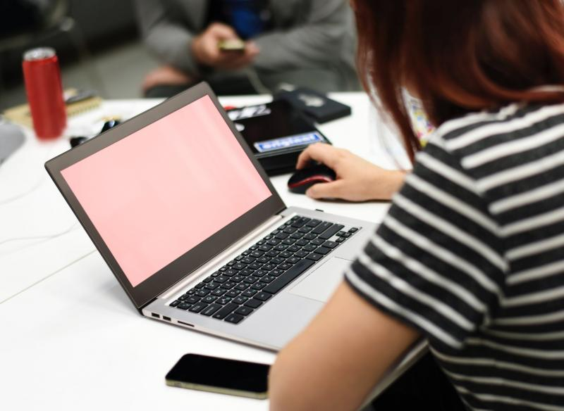 girl on laptop with pink screen